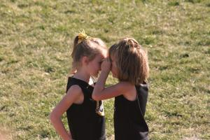 girls sharing secrets